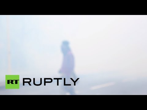 Clouds of tear gas rain down on protesters during anti-police brutality rally in France