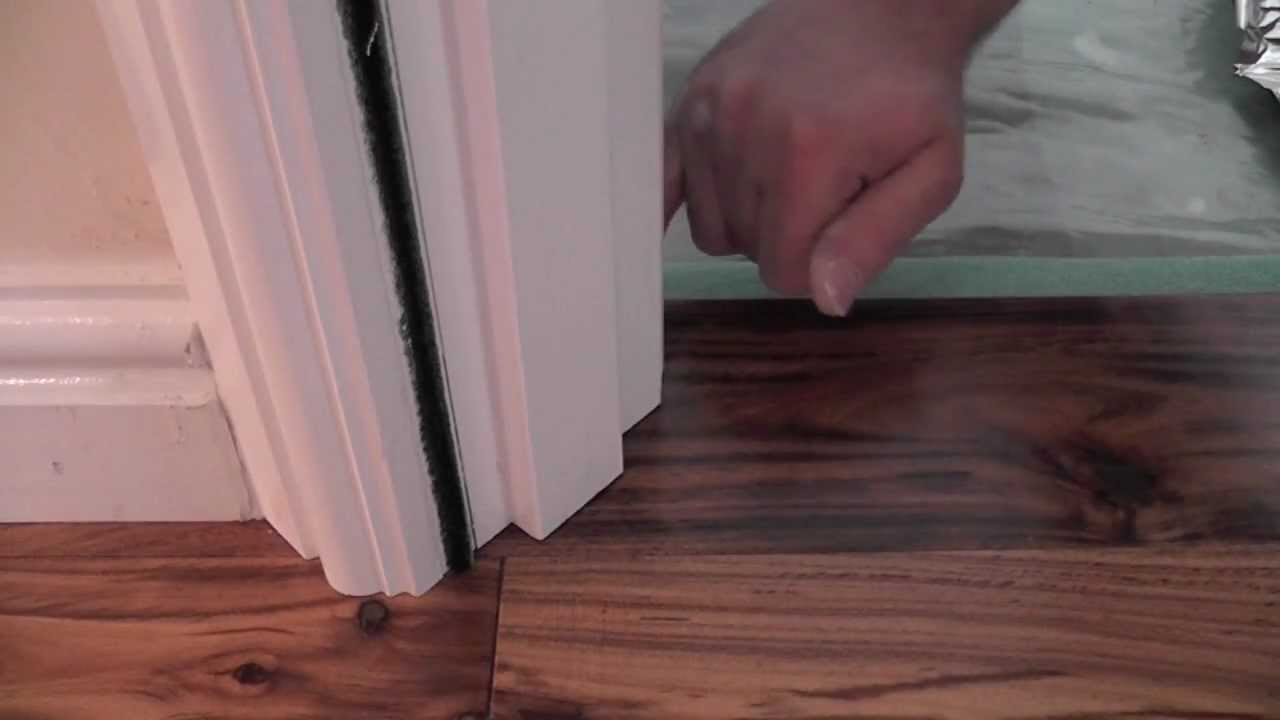 Floor trim how to undercut a door frame tutorial youtube for Door undercut