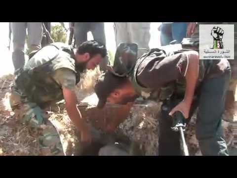 الجيش الحر يدمر رتل ويقبض على شبيح مختبئ مثل القذافي