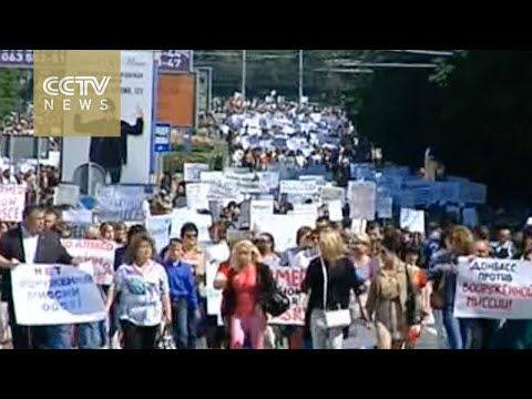 Thousands protest OSCE presence in rebel-held Ukraine