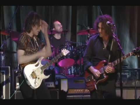Guitar battle: Steve Vai & Dweezil Zappa -- Zappa plays Zappa DVD concert.