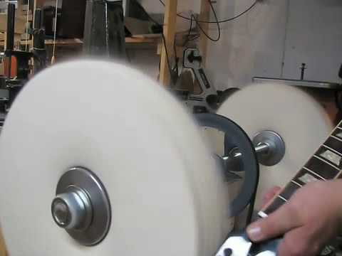 shop built buffer luthier buffing out a les paul guitar repair