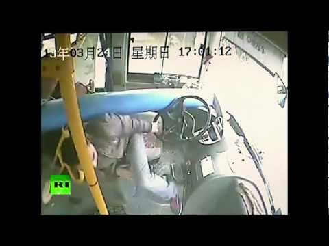 CCTV: Chinese bus driver dodges death as pole smashes through windscreen