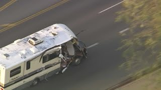 Dog jumps from motor home during police chase