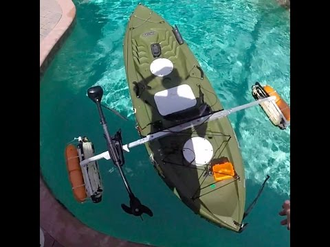 Kayak trolling motor with outriggers