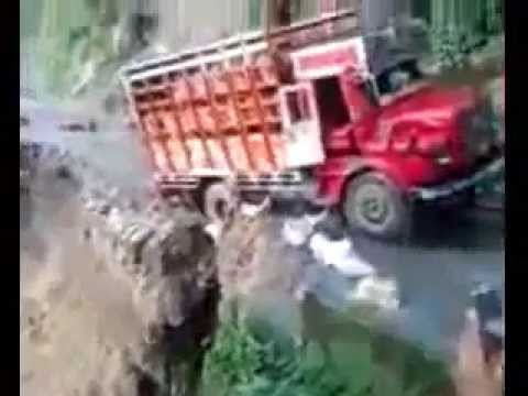 Truck falling from hills   Heavy rains wreak havoc north India, Uttarakhand worst hit