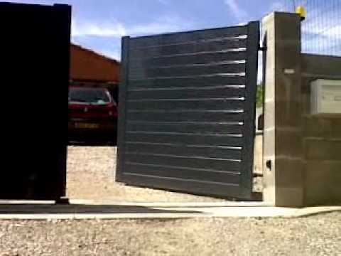 Motorisation portail 2 vantaux sol en pente youtube for Gond pour portail en pente leroy merlin