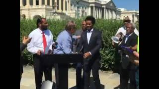 Olympian Feyisa Lilesa speaking at press conference in Washington DC about oppression in Ethiopia.