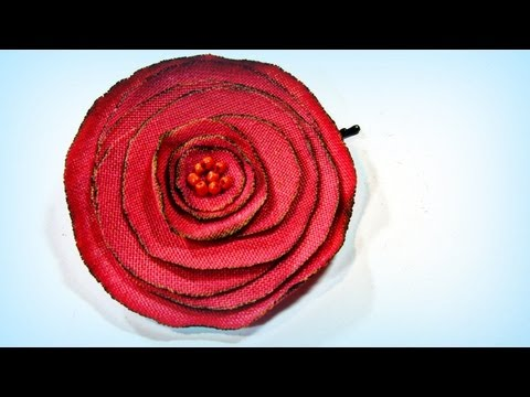 Cómo hacer rosas de tela. How to make fabric roses.
