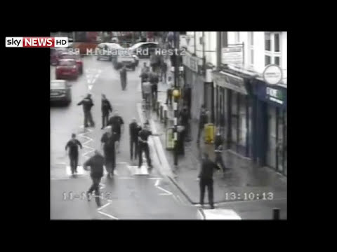 Policeman Tackles Sword-Wielding Attacker