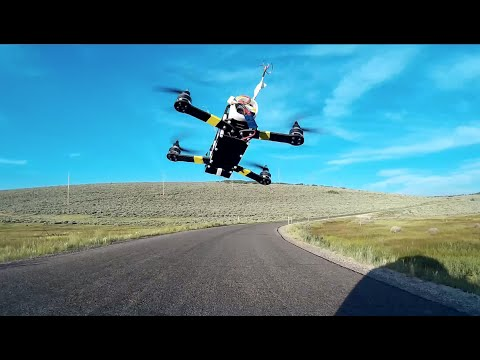 FPV Drone Racing from Moving Car