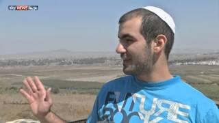 """إسرائيليون بالجولان لـ""""التمتع""""بمنظر المعارك"""
