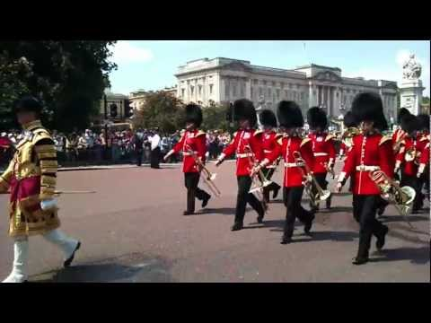 Queens Guard on parade outside Buckingham Palace in London England