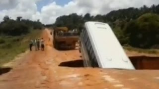 A brazil tourist bus fell through a large crater hole, washed away by flood