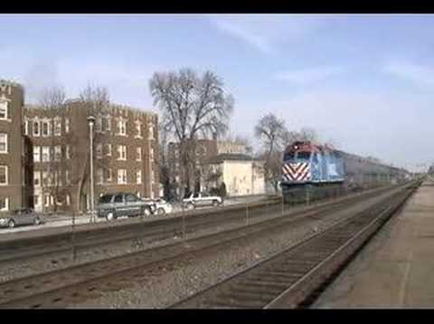 Metra F40PHM-2 194 leads an outbound (westbound) commuter train into the Riverside Metra Station (Riverside, IL.) for its stop. This train is running on the ...