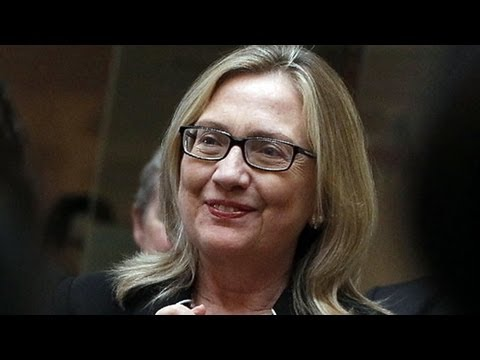 Hillary Clinton No Makeup, Hair Pulled Back; Makes Own 'Texts From Hillary' Meme (2012)