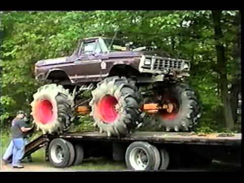 3 Monster Mud trucks-unloading from Trailer