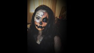 Pumpkin face painting by Arlette T