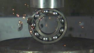 Crushing ball bearings with hydraulic press