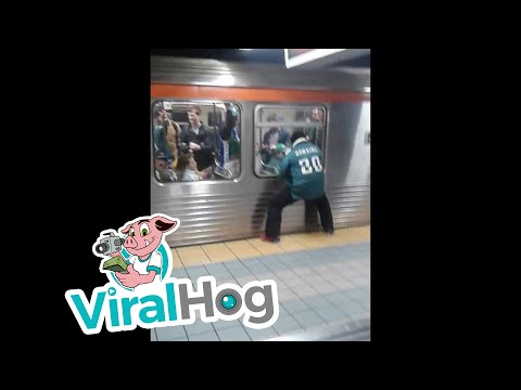 Excited Eagles Fans Runs Into Subway Pole || ViralHog