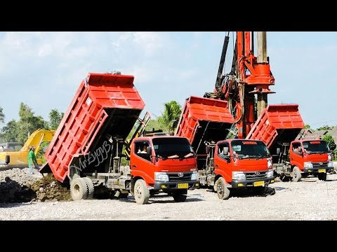 Dump Truck Toyota Dyna and Excavator Unloading Material