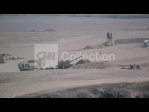 MIDEAST: ISRAELI ARTILLERY FIRING INTO GAZA