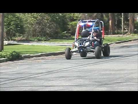 My Police Go-Kart being started and Rode around with lights and sirens