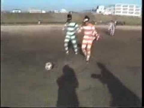 Japanese Guys Play Soccer With Binoculars On