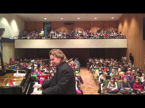 Silvan Zingg Playing His Boogie Woogie Piano Music In Schools. video
