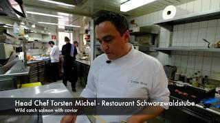 Head Chef Torsten Michel prepares a wild catch salmon dish in restaurant Schwarzwaldstube, Germany
