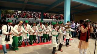 Jaunsari folk dancers perform to flute player Sarju Verma's tune