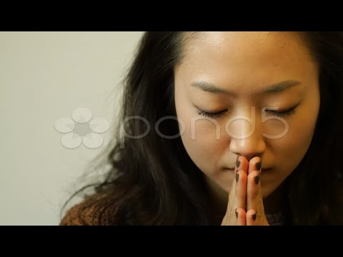 Young Asian Woman Putting Hands Together To Pray. Stock Footage