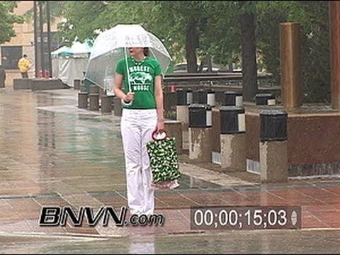 6/4/2005 General Video Of People In Heavy Rain News Footage