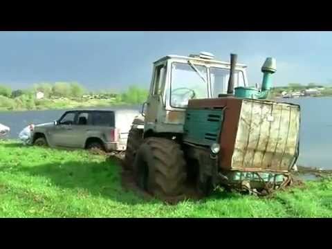 Nissan Patrol stuck in a swamp. tractor rescues. Offroad