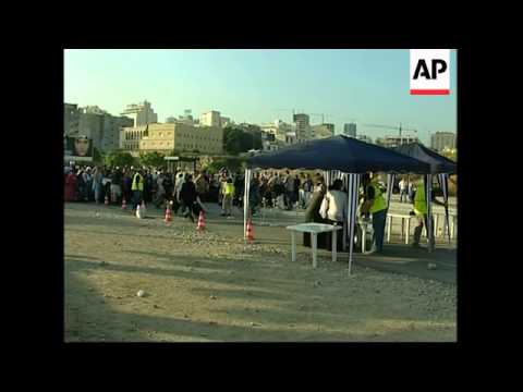 WRAP Aftermath of first attack on Sidon, mosque hit; S. Beirut hit; Belgian, Aus evacuees
