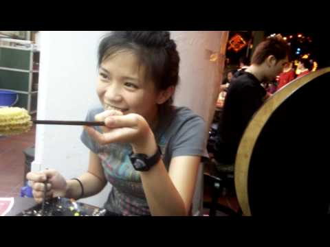 singaporean teen girl does not know how to unstuck the chopstick she poked ...