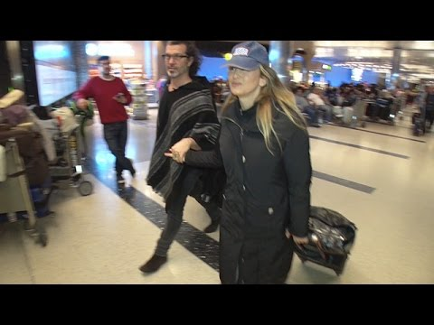 Renee Zellweger Keeps Ahold Of Her Man At The Airport