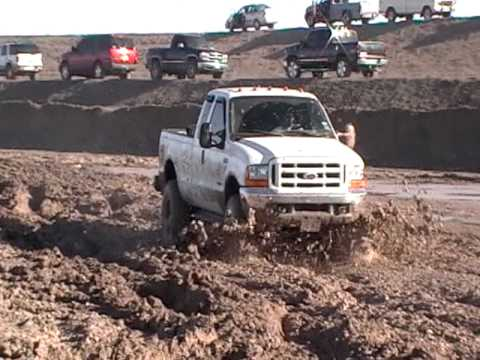 Lifted Ford F-250 mudding w/michelin tires