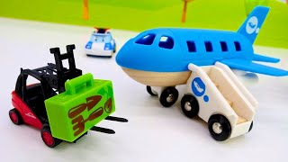 Toy Helper cars and trucks for toddlers at the airport: A toy train & a toy plane