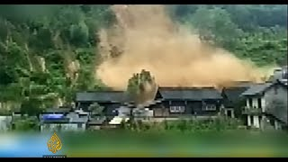 Dramatic footage as landslide destroys homes in China
