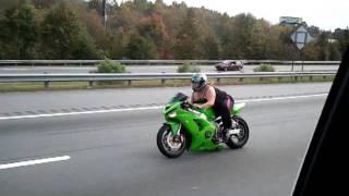 Fat chick on street bike