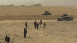 Iraq: Air strikes on Mosul help breach Islamic State group's defences