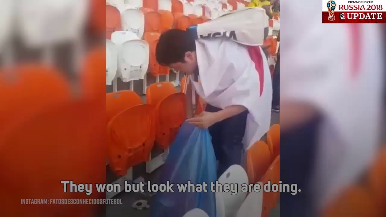 Senegal, Japan fans clean up after matches at World Cup