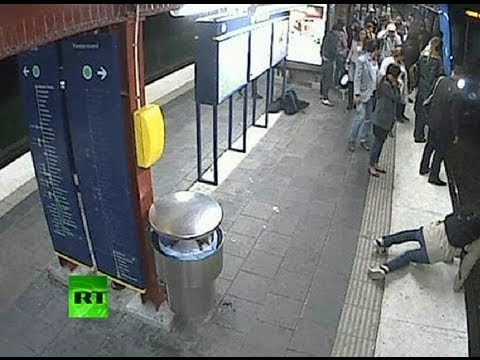 Shock CCTV: Man falls onto tracks, gets robbed and run over by train