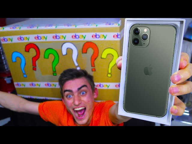 UNBOXING 100,000 EBAY MYSTERY BOX OMG IPHONE 11 PRO!?