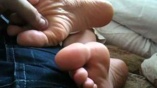My gf's feet and wrinkled soles in my lap