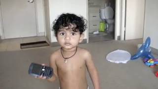 funny baby imitating dad