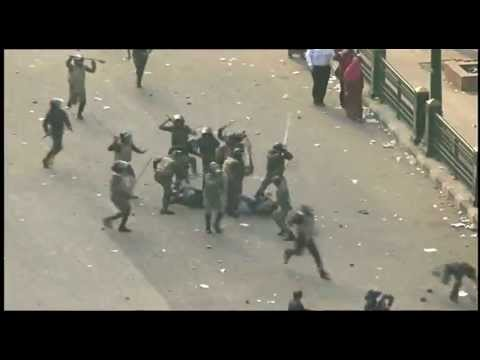 Brutal Egypt security force beat woman unconscious ( shocking, very graphic ) SHARE