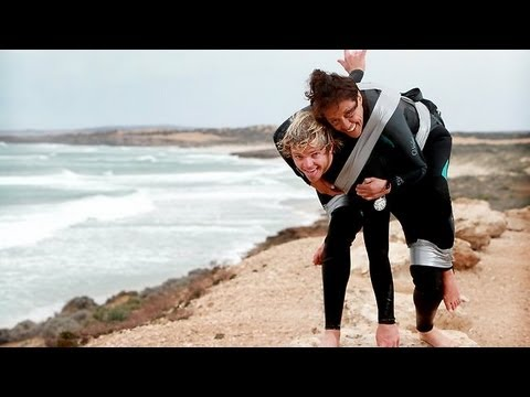 Paralyzed mom goes surfing duct taped on the back of a man on South Australia's West Coast