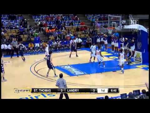 St. Thomas More #4 Orynn Veillon elevates for the alley oop slam